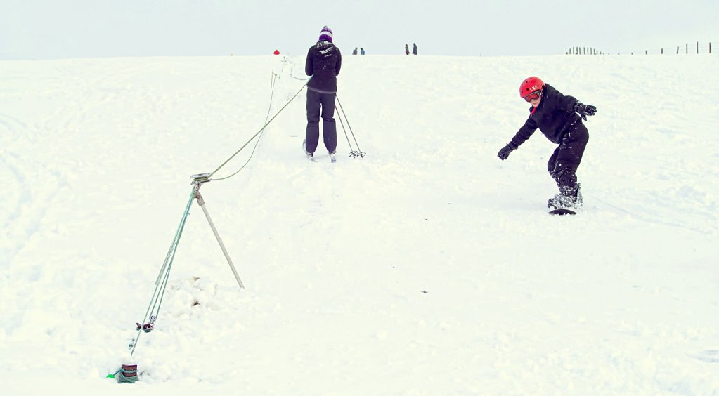 Rope tow and snow boarder