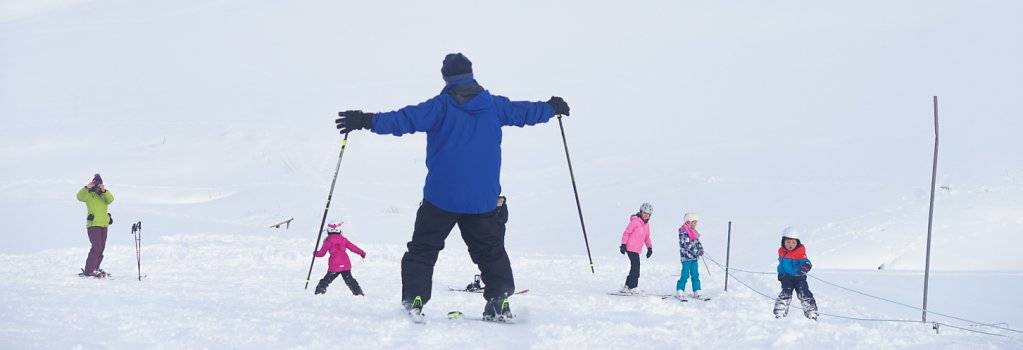children-and-adults-learning-to-ski.jpg